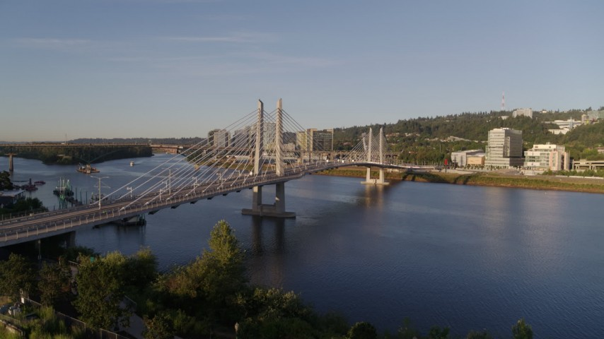 4K stock footage aerial video of Tilikum Crossing, Bridge of the People spanning Willamette River, South Portland, Oregon Aerial Stock Footage | DX0001_000189