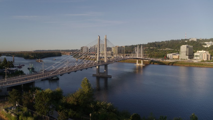 4K stock footage aerial video ascend to approach the Tilikum Crossing, Bridge of the People, spanning Willamette River, South Portland, Oregon Aerial Stock Footage | DX0001_000190