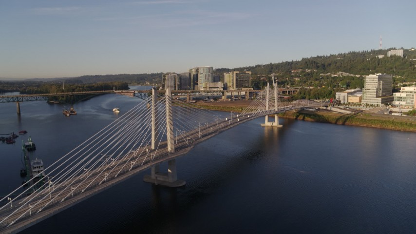 4K stock footage aerial video of Tilikum Crossing, Bridge of the People, spanning the Willamette River, South Portland, Oregon Aerial Stock Footage | DX0001_000191
