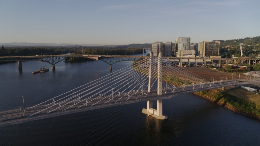 4K stock footage aerial video flying away from Tilikum Crossing, Bridge of the People, spanning Willamette River, South Portland, Oregon Aerial Stock Footage | DX0001_000193