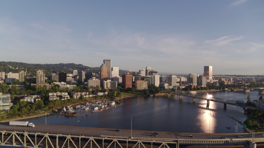 4K stock footage aerial video flying away from Riverplace Marina and over Marquam Bridge, Downtown Portland, Oregon Aerial Stock Footage DX0001_000197 | Axiom Images