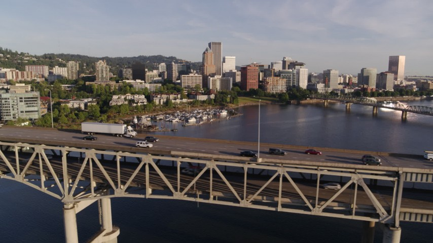 4K stock footage aerial video tracking traffic on Marquam Bridge spanning Willamette River, Downtown Portland, Oregon Aerial Stock Footage | DX0001_000199