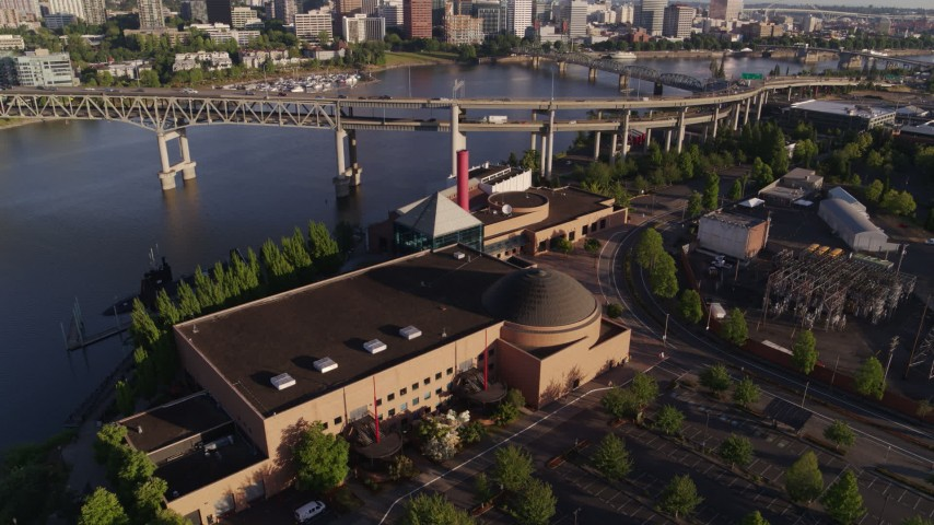 5.7K stock footage aerial video flying away from OSMI, Marquam Bridge and Willamette River, Southeast Portland, Oregon Aerial Stock Footage | DX0001_000207