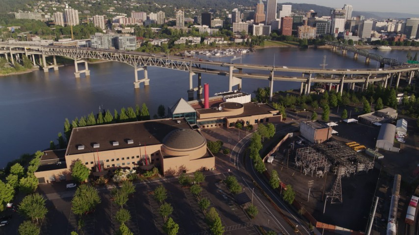 5.7K stock footage aerial video approaching OMSI, with Marquam Bridge and downtown in the background, Southeast Portland, Oregon Aerial Stock Footage | DX0001_000211