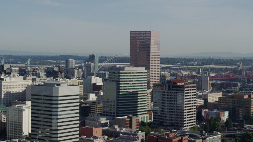 5.7K stock footage aerial video flying by U.S. Bancorp Tower, skyscrapers on a partly cloudy day, Downtown Portland, Oregon Aerial Stock Footage | DX0001_000213