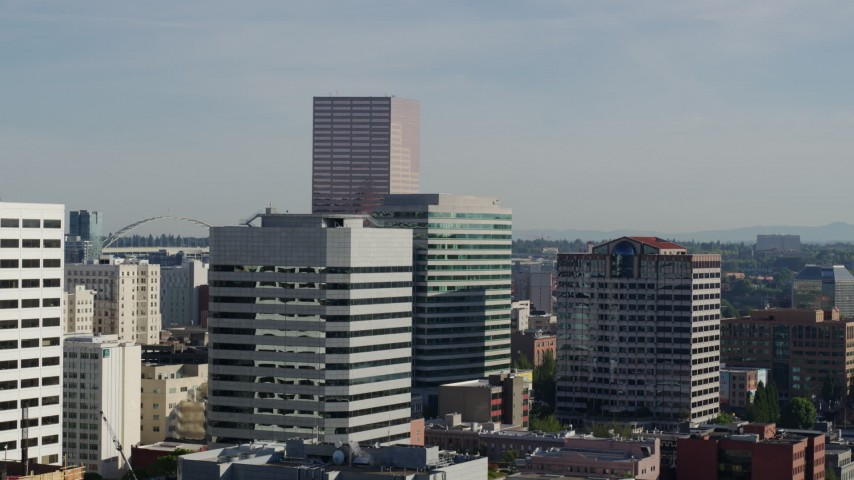 5.7K stock footage aerial video of the U.S. Bancorp Tower, descending behind buildings, Downtown Portland, Oregon Aerial Stock Footage | DX0001_000214