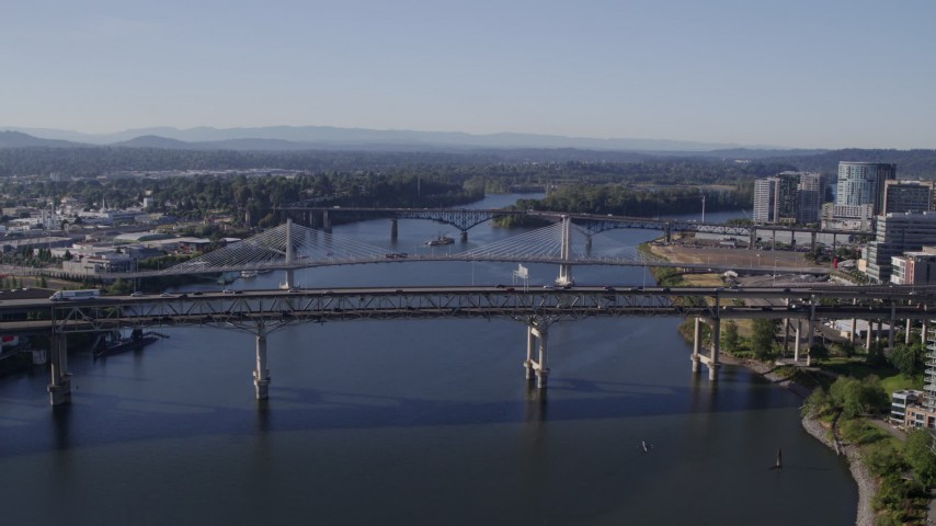 5.7K stock footage aerial video of the Marquam Bridge (I-5) spanning the Willamette River, South Portland, Oregon Aerial Stock Footage | DX0001_000215