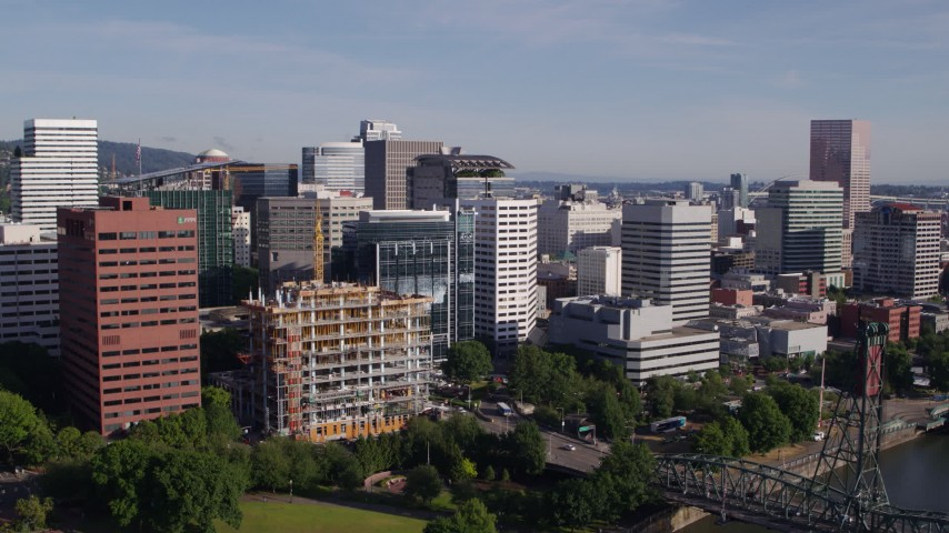 5.7K stock footage aerial video of downtown buildings, descending over the Willamette River, Downtown Portland, Oregon Aerial Stock Footage | DX0001_000219