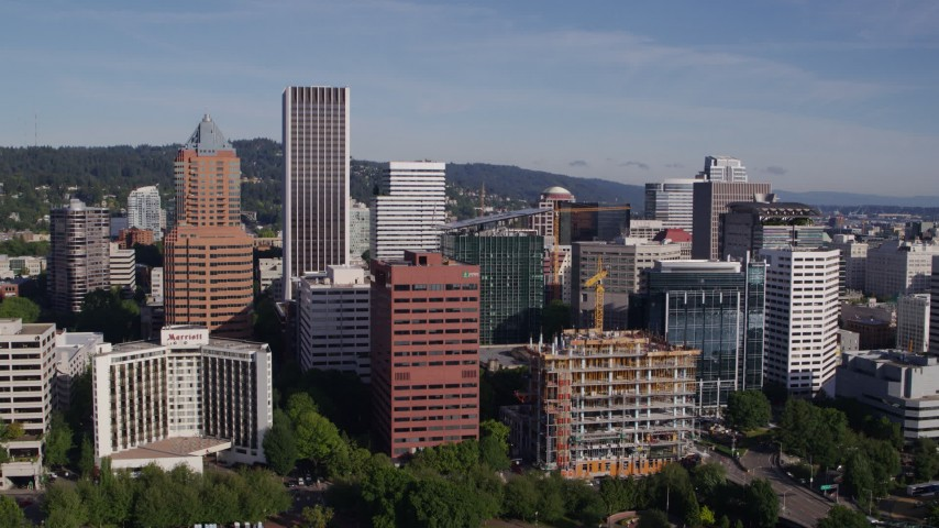 5.7K stock footage aerial video approaching downtown buildings and skyscrapers, Downtown Portland, Oregon Aerial Stock Footage DX0001_000224 | Axiom Images