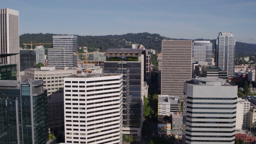 5.7K stock footage aerial video flying closely by downtown skyscrapers and office buildings, partly cloudy, Downtown Portland, Oregon Aerial Stock Footage | DX0001_000226
