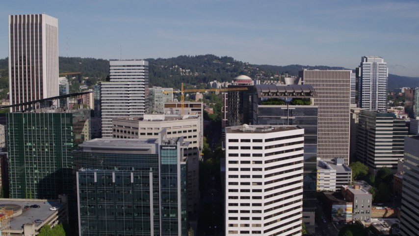 5.7K stock footage aerial video flying by downtown skyscrapers on a partly cloudy day, Downtown Portland, Oregon Aerial Stock Footage | DX0001_000227
