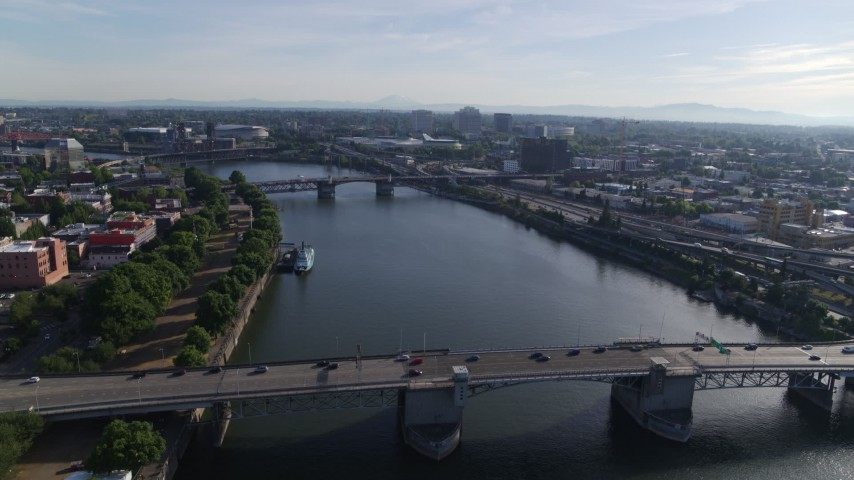 5.7K stock footage aerial video stationary shot of Morrison Bridge with light traffic spanning the Willamette, Downtown Portland, Oregon Aerial Stock Footage | DX0001_000232