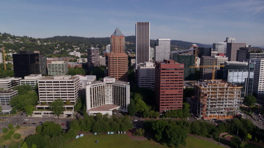 5.7K stock footage aerial video flying away from downtown buildings and the waterfront park in Downtown Portland, Oregon Aerial Stock Footage | DX0001_000235