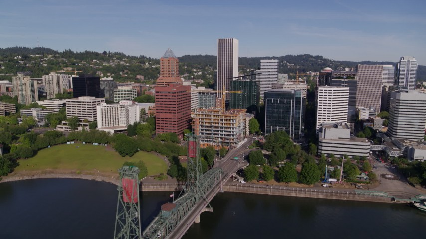 5.7K stock footage aerial video of downtown office buildings, skyscrapers, and waterfront park in Downtown Portland, Oregon Aerial Stock Footage | DX0001_000236