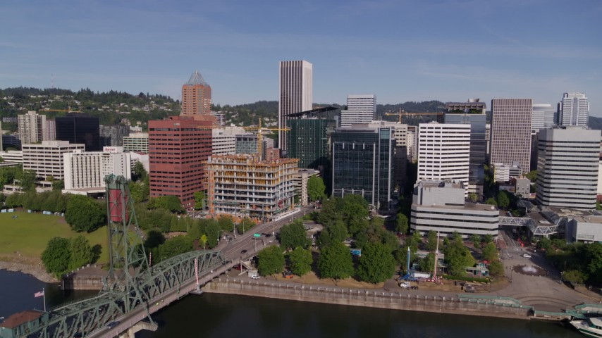 5.7K stock footage aerial video approaching office buildings and KOIN Center from the river in Downtown Portland, Oregon Aerial Stock Footage | DX0001_000237