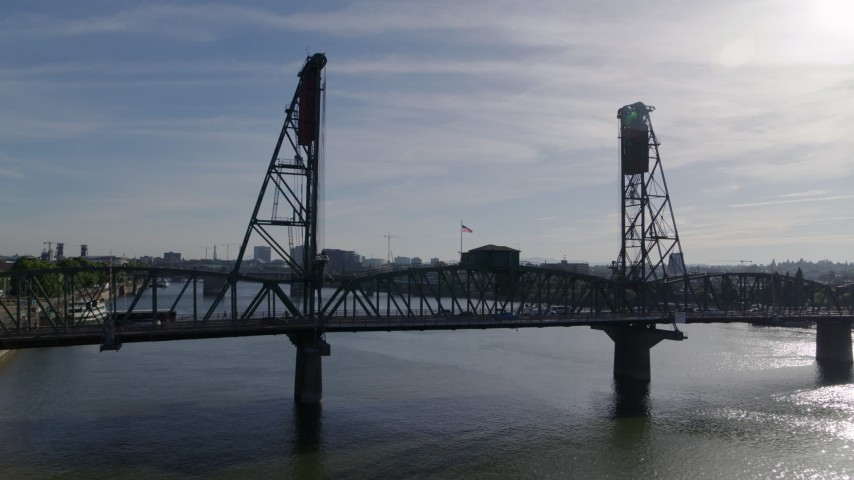 5.7K stock footage aerial video flying over Hawthorne bridge spanning Willamette River, Downtown Portland, Oregon Aerial Stock Footage | DX0001_000238