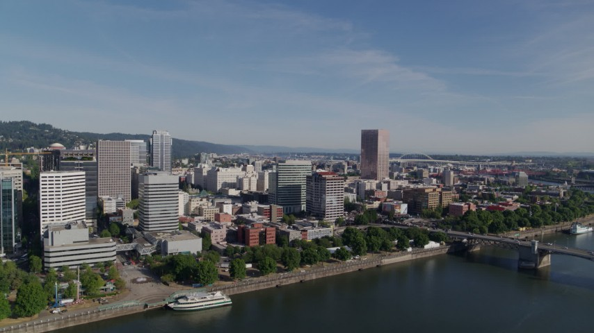 5.7K stock footage aerial video of downtown office buildings along the river, Downtown Portland, Oregon Aerial Stock Footage | DX0001_000241