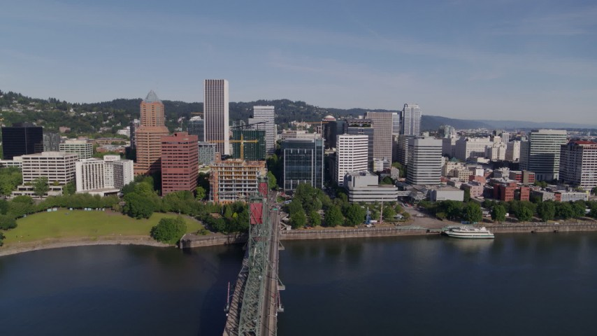5.7K aerial video of downtown and the Hawthorne Bridge spanning Willamette River, Downtown Portland, Oregon Aerial Stock Footage | DX0001_000242