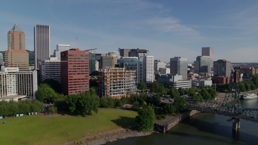 6K stock footage aerial video approaching downtown and waterfront park from Willamette River, Downtown Portland, Oregon Aerial Stock Footage | DX0001_000243