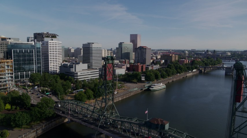 5.7K aerial video flyby waterfront office buildings and over Hawthorne Bridge, Downtown Portland, Oregon Aerial Stock Footage | DX0001_000244