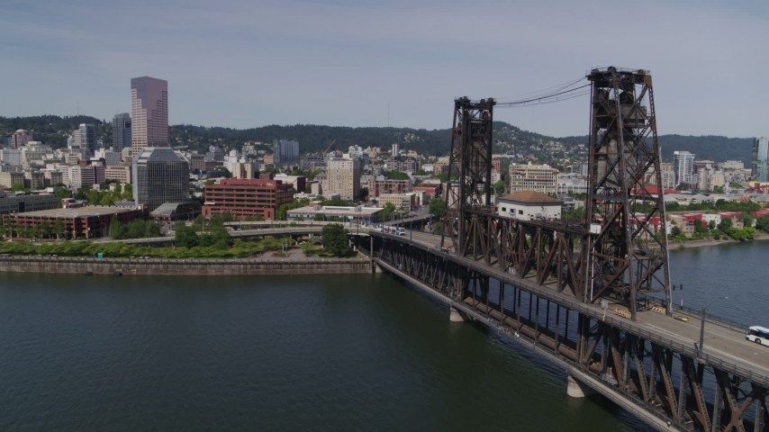 5.7K stock footage aerial video flying by Steel Bridge and revealing waterfront apartment buildings, Downtown Portland, Oregon Aerial Stock Footage | DX0001_000246