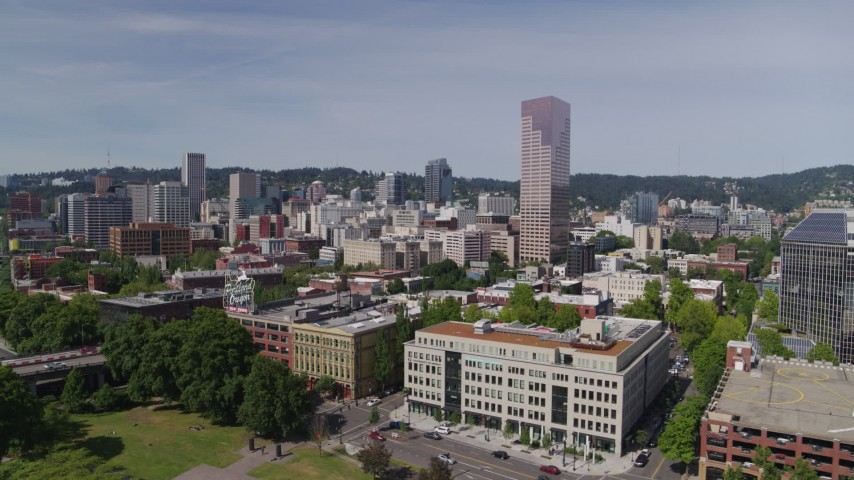 5.7K stock footage aerial video side view of office buildings and White Stag sign, Downtown Portland, Oregon Aerial Stock Footage | DX0001_000247