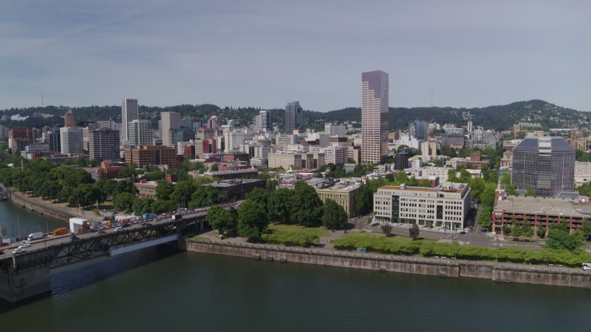 5.7K stock footage aerial video of Burnside Bridge and the iconic White Stag building and sign, Downtown Portland, Oregon Aerial Stock Footage | DX0001_000249