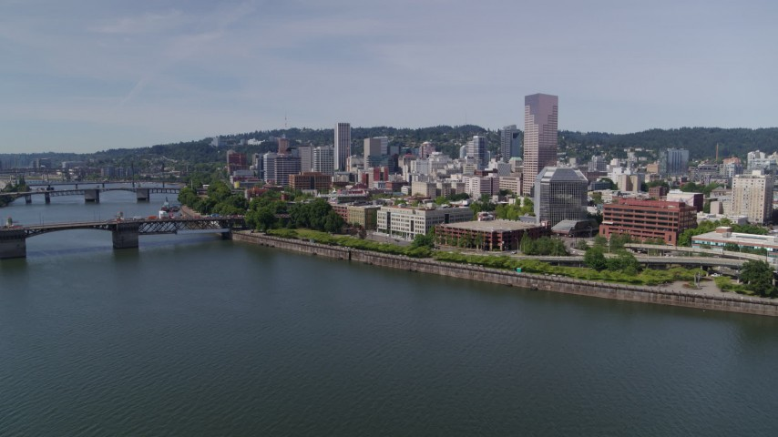 5.7K stock footage aerial video descending to stationary over Willamette River, looking toward Downtown  Portland, Oregon Aerial Stock Footage | DX0001_000255
