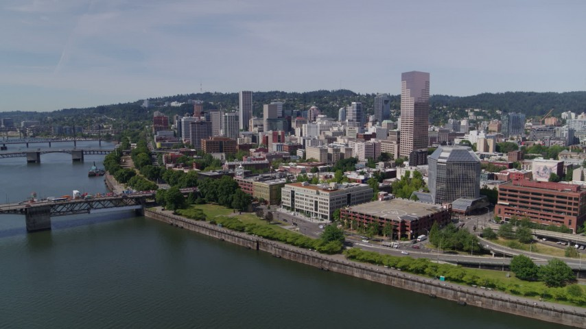 5.7K stock footage aerial video fly over Willamette River, to approach Downtown Portland, Oregon Aerial Stock Footage | DX0001_000256