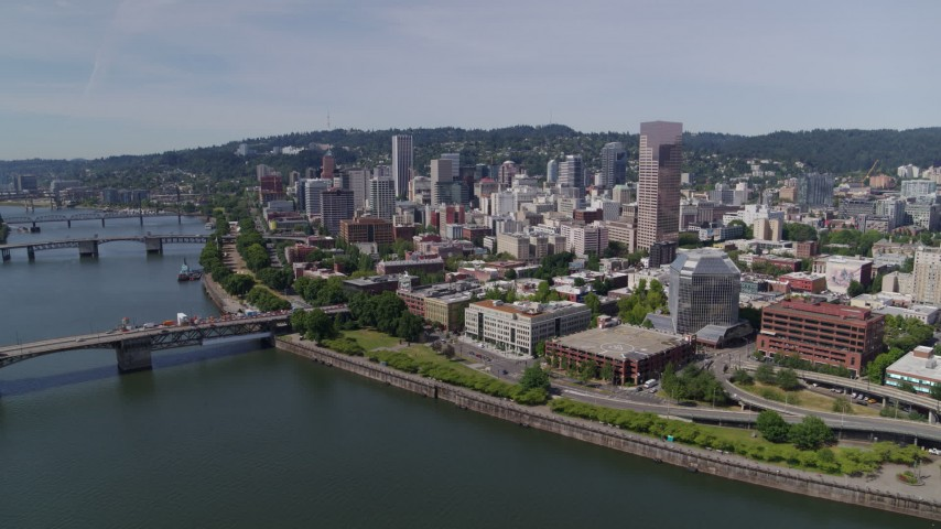 5.7K stock footage aerial video reverse and fly over Willamette River from Downtown Portland, Oregon Aerial Stock Footage | DX0001_000257
