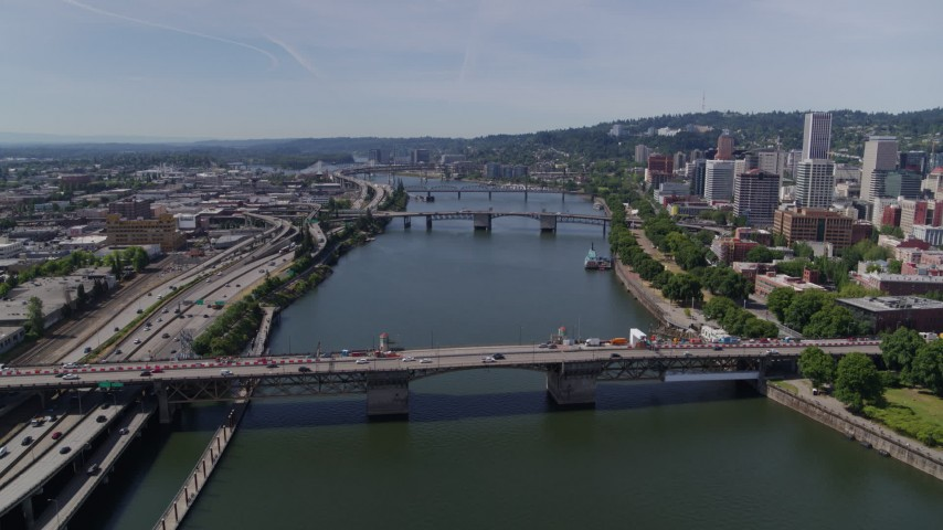 5.7K stock footage aerial video approach of downtown bridges spanning Willamette River, Downtown Portland, Oregon Aerial Stock Footage | DX0001_000258