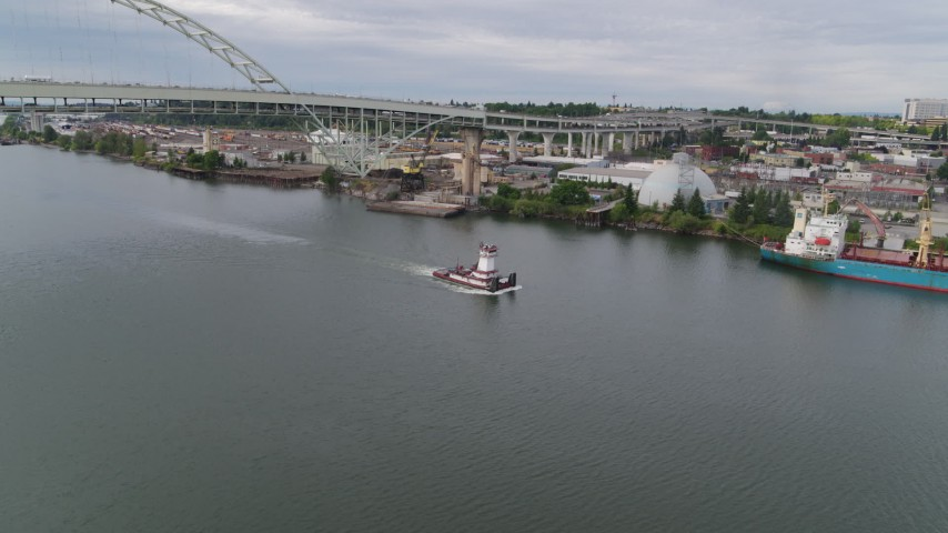 5.7K stock footage aerial video of a tugboat in the river, North Portland, Oregon Aerial Stock Footage | DX0001_000264