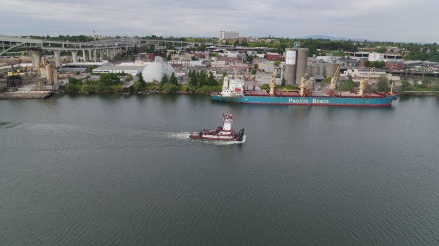 5.7K stock footage aerial video of tracking tugboat sailing the Willamette River by North Portland, Oregon Aerial Stock Footage | DX0001_000265