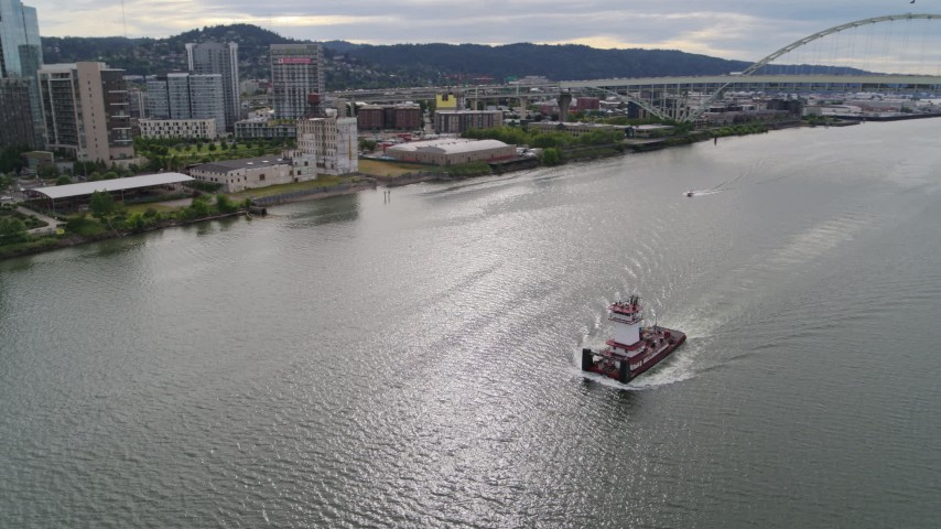 5.7K stock footage aerial video tracking a tugboat and revealing Fremont Bridge, Downtown Portland, Oregon Aerial Stock Footage | DX0001_000266