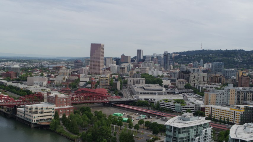 5.7K stock footage aerial video of a reverse view of Downtown Portland, Oregon at sunset, revealing condominiums Aerial Stock Footage | DX0001_000283