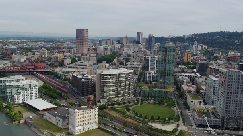 5.7K stock footage aerial video of downtown seen from Pearl District condominiums and a park, Downtown Portland, Oregon Aerial Stock Footage | DX0001_000285