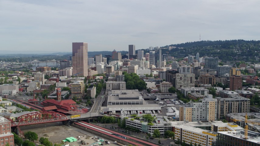 5.7K stock footage aerial video flying over condominiums toward downtown skyscrapers, sunset, Downtown Portland, Oregon Aerial Stock Footage DX0001_000286 | Axiom Images