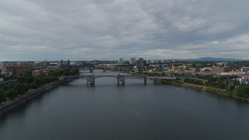 5.7K stock footage aerial video reverse over Hawthorne Bridge from Morrison Bridge spanning the Willamette, sunset, Southeast Portland, Oregon Aerial Stock Footage | DX0001_000289