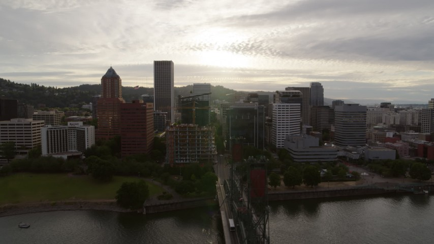 5.7K stock footage aerial video of the setting sun behind the downtown skyline, sunset, Downtown Portland, Oregon Aerial Stock Footage | DX0001_000290