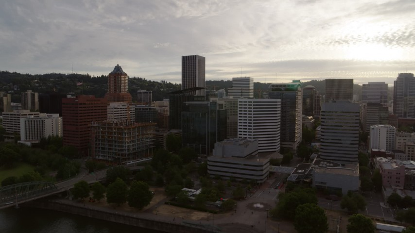 5.7K stock footage aerial video of approaching office buildings near the river at sunset, Downtown Portland, Oregon Aerial Stock Footage | DX0001_000291