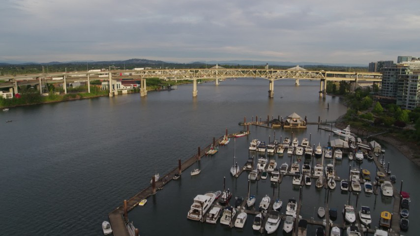 5.7K stock footage aerial video fly over marina toward bridges, sunset, South Portland, Oregon Aerial Stock Footage | DX0001_000293