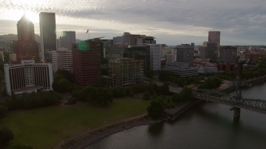 5.7K stock footage aerial video approaching Downtown Portland, Oregon from the river, sunset Aerial Stock Footage | DX0001_000296