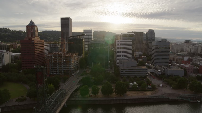 5.7K stock footage aerial video of skyscrapers and office buildings near the Willamette River at sunset, Downtown Portland, Oregon Aerial Stock Footage | DX0001_000297