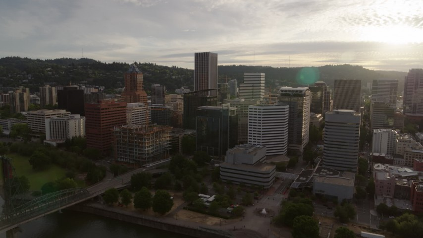 5.7K stock footage aerial video of downtown office buildings near the river at sunset, Downtown Portland, Oregon Aerial Stock Footage | DX0001_000298