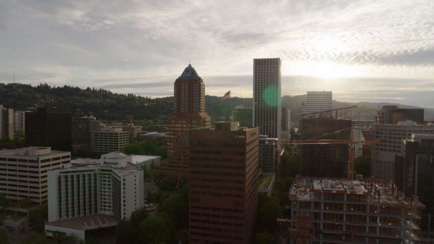 5.7K stock footage aerial video of city buildings near the river at sunset, Downtown Portland, Oregon Aerial Stock Footage | DX0001_000299