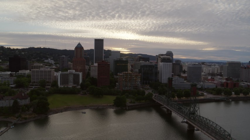 5.7K stock footage aerial video flying over the Hawthorne Bridge with a view of the Downtown Portland skyline at sunset, Oregon Aerial Stock Footage | DX0001_000301