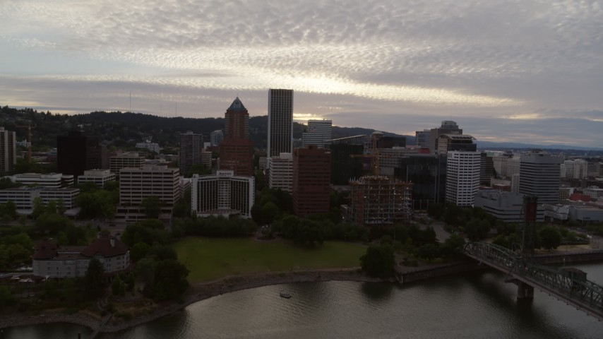 5.7K stock footage aerial video approaching the KOIN Center and Marriott Hotel from the Willamette River, sunset, Downtown Portland, Oregon Aerial Stock Footage | DX0001_000302