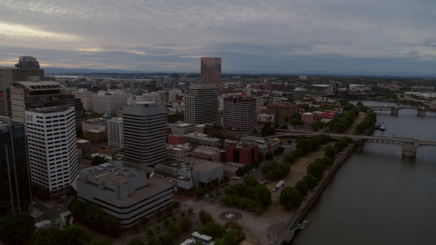 5.7K stock footage aerial video flying away from the Morrison Bridge with Downtown Portland office buildings to the west, twilight, Oregon Aerial Stock Footage | DX0001_000304