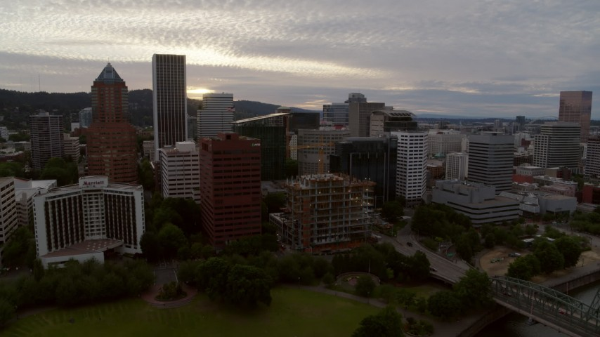 5.7K stock footage aerial video flying away from Downtown Portland office buildings and hotel at twilight, Oregon Aerial Stock Footage | DX0001_000305