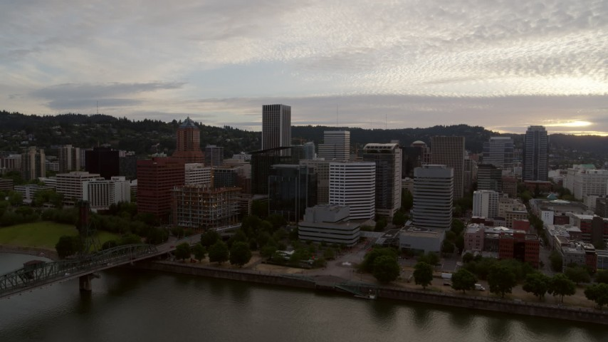 5.7K stock footage aerial video of the Downtown Portland skyline from Willamette River, twilight, Oregon Aerial Stock Footage | DX0001_000307